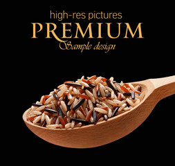 Assorted rice in a wooden spoon  isolated on black background