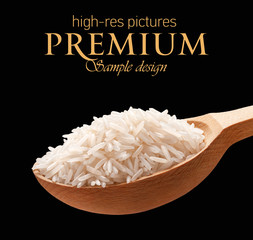 Basmati rice in a wooden spoon  isolated on black background