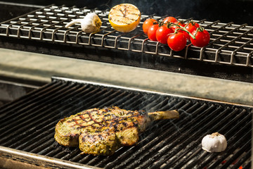 steak flame broiled on a barbecue