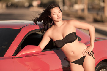 Beautiful Asian Woman in Bikini with Sports Car