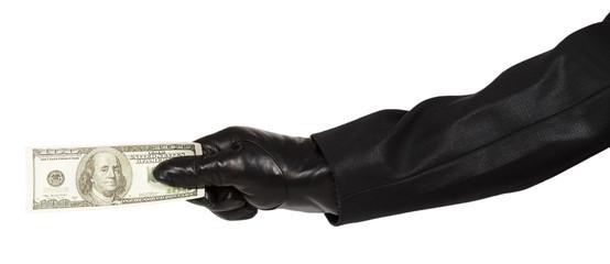 Hand in black glove holding money