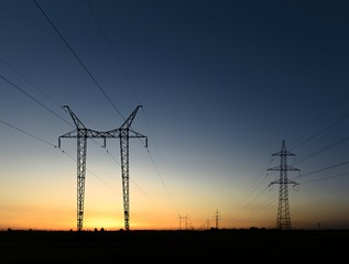 Large transmission towers at sunset