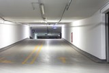 Empty underground parking lot poster