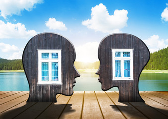 Two silhouettes of human head with windows inside