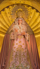 Seville- cried tradicional vestet Virgin Mary statue