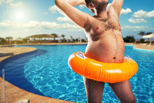 Strange naked man at the pool - 74648376