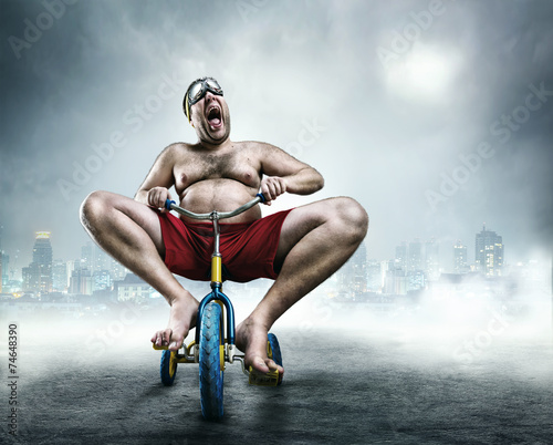 Nerdy man riding a small bicycle - 74648390