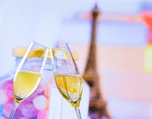 a pair of champagne flutes on blur tower Eiffel background