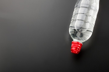 Plastic water bottle on grey