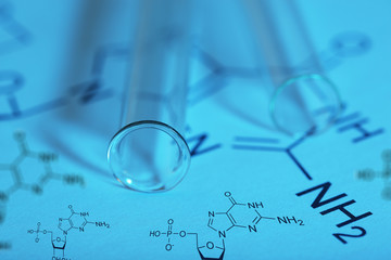 Test tubes and reaction formula, close-up