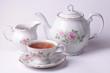 Leinwandbild Motiv Traditional english tea with white tea set floral dishware