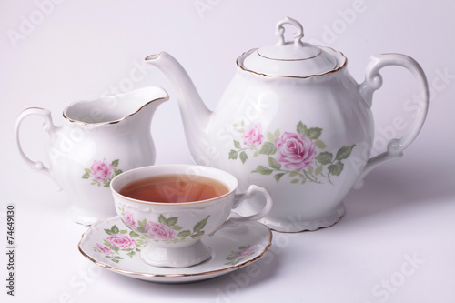 Traditional english tea with white tea set floral dishware - 74649130
