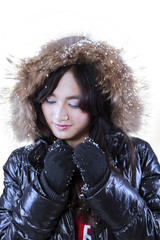 Attractive girl in winter clothes with fur hood