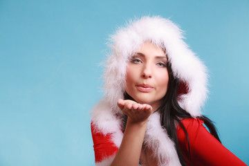 Portrait woman wearing santa clause costume on blue