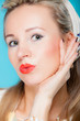Portrait beautiful woman pinup girl retro style blowing a kiss