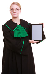 Woman lawyer attorney in classic polish gown holds tablet blank