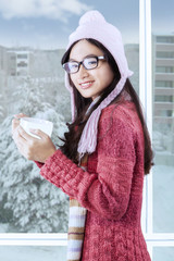 Beautiful smiling girl with winter clothes