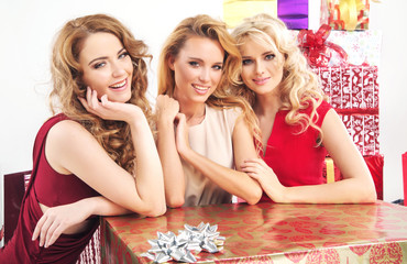 Three pretty women with huge present
