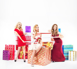 Group of pretty ladies with Christmas gifts