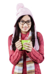 Excited teenage girl in winter clothes