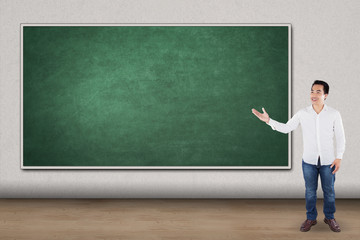 Man presents empty blackboard