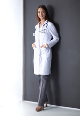 Doctor woman with stethoscope isolated on grey background