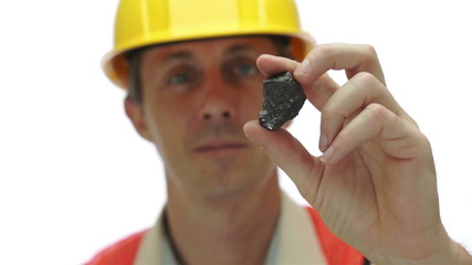 Miner Inspects Carbon Graphite Ore