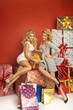 Two sensual girlfriends among Chritsmas gifts