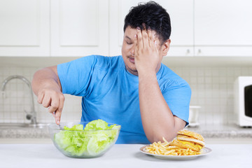Overweight person chooses to eat salad 1