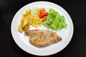 Pork chops steak with salad and french fried