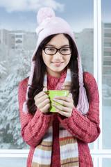 Sweet teenage girl smiling at the camera