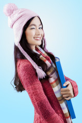 Young lady in winter clothes wink