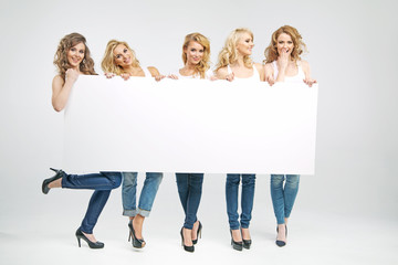 Pretty women holding empty board