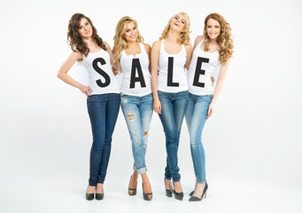 Four attractive women promoting sale