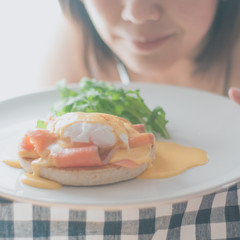 Egg Benedict with smoked salmon on serve