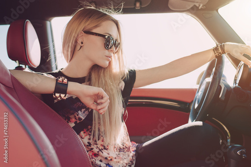 Blondie young girl at the wheel of sport car - 74653392
