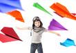 Cute little pilot among colorful paper planes