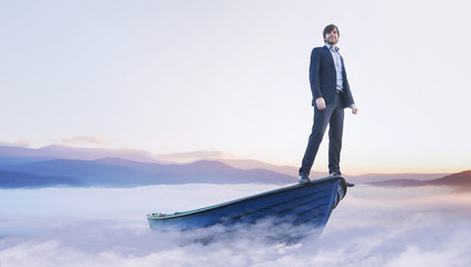 Young handsome man on wooden boat