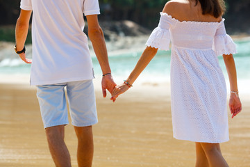 couple walking on beach together