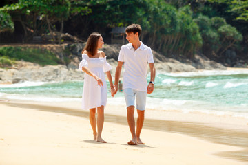 lovely couple walking on beach together