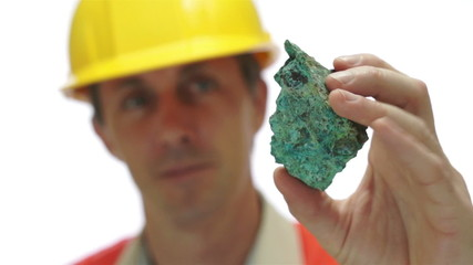 Miner Inspects Copper Carbonate Ore