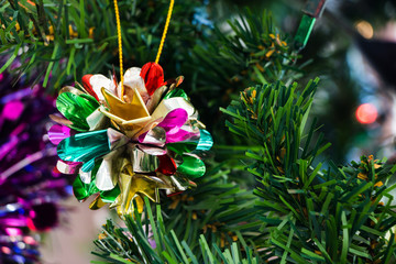 Close up of christmas tree ornaments.