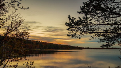 Sunset over lake in Autumn time lapse