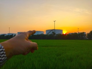 hand pointing at oil tank