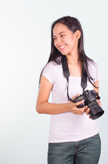 Young woman photographer with digital camera