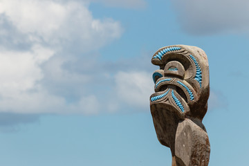 Maori totem against blue sky