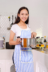 Asian girl is happy with cooking