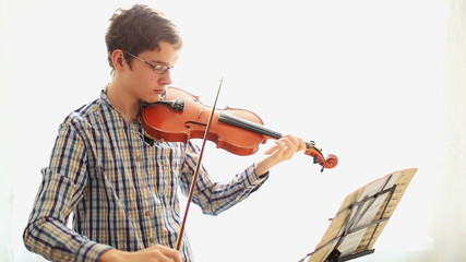 Violinist,  Young man playing the violin