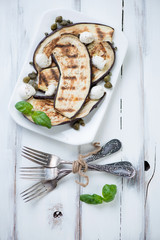 Grilled aubergines with capers, mozzarella, pepper and basil