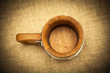 Wooden mug top view. Photo toned in yellow